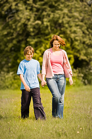 Woman and boy walking outside